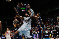 SPAIN, Madrid: Real Madrid's Greek player Ioannis Bourousis and Ucam Murcia&acute;s Spanish player Jose Angel Antelo Paredes during the Liga Endesa Basket 2014/15 match between Real Madrid and Ucam Murcia, at Palacio de los Deportes in Madrid on November 16, 2014. /NortePhoto<br />