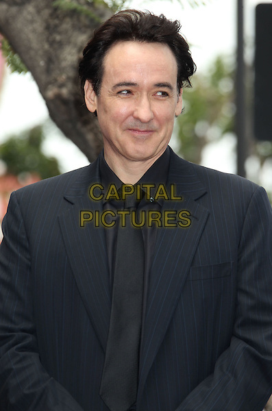 John Cusack.John Cusack Honored With A Star On The Hollywood Walk Of Fame, Hollywood, CA., USA..April 24th, 2012.half length black suit .CAP/ADM/RE.©Russ Elliot/AdMedia/Capital Pictures.