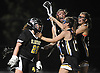 Delaney Galvin #22, St. Anthony's goalie, gets mobbed by teammates after the Lady Friars' 11-7 ein over Sacred Heart Academy in the Nassau-Suffolk CHSAA varsity girls lacrosse Class AAA final at Adelphi University on Thursday, May 18, 2017.