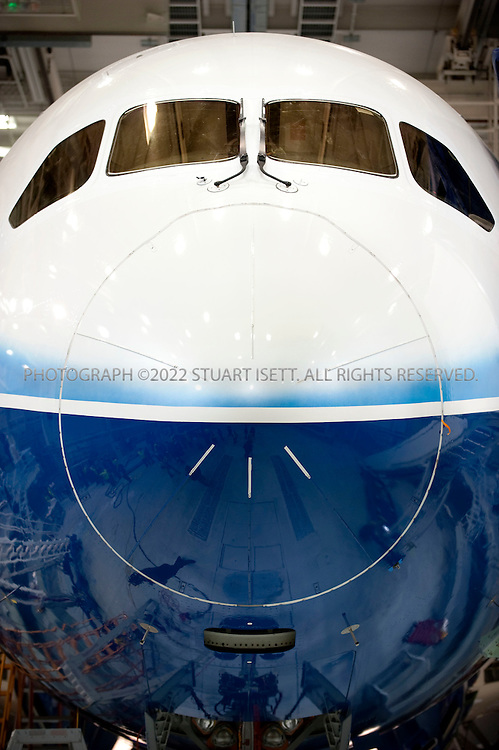 4/30/2009--Everett, WA, USA..At Boeing's Everett, Wash., the first Boeing 787 under production that will be used in the first test flights that Boeing expects in the second quarter of 2009...The 787-8 Dreamliner will carry 210 - 250 passengers on routes of 7,650 to 8,200 nautical miles (14,200 to 15,200 kilometers), while the 787-9 Dreamliner will carry 250 - 290 passengers on routes of 8,000 to 8,500 nautical miles (14,800 to 15,750 kilometers).  A third 787 family member, the 787-3 Dreamliner, will accommodate 290 - 330 passengers and be optimized for routes of 2,500 to 3,050 nautical miles (4,600 to 5,650 kilometers). ..In addition to bringing big-jet ranges to mid-size airplanes, the 787 will provide airlines with unmatched fuel efficiency, resulting in exceptional environmental performance. The airplane will use 20 percent less fuel for comparable missions than today's similarly sized airplane. It will also travel at speeds similar to today's fastest wide bodies, Mach 0.85. Airlines will enjoy more cargo revenue capacity. Passengers will also see improvements with the new air..Photograph ©2009 Stuart Isett.All rights reserved