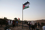 Palestinian protesters rise the Palestinian flag at the Bedouin village of Khan al-Ahmar, in the occupied West Bank against Israel's plan to demolish the village on September 26, 2018. Photo by Shadi Hatem