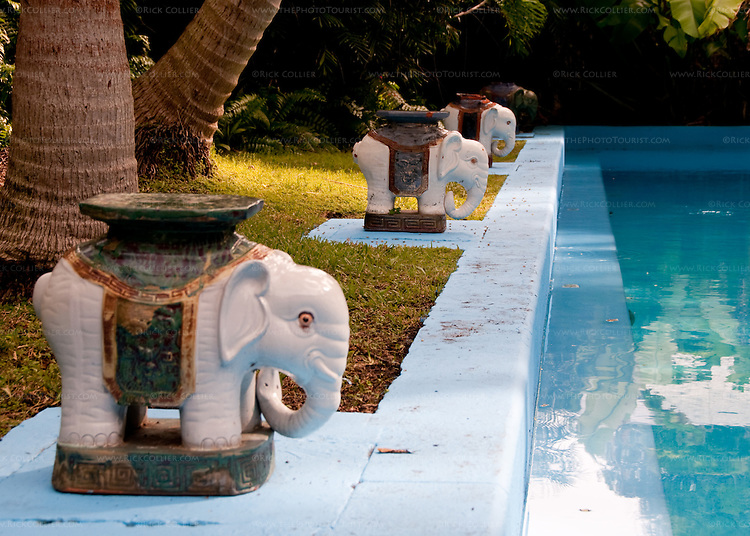 Elephant seats adorn the edges of the pool at the Hemingway House, Key West, Florida, USA.