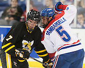 Alexander MacMillan (AIC - 7), Joe Gambardella (UML - 5) - The University of Massachusetts Lowell River Hawks defeated the visiting American International College Yellow Jackets 6-1 on Tuesday, December 3, 2013, at Tsongas Arena in Lowell, Massachusetts.