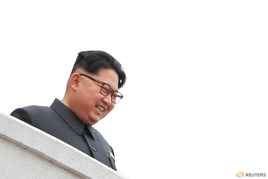North Korean leader Kim Jong Un smiles from the balcony as he presides over a mass rally and parade in the capital's main ceremonial square, a day after the ruling party wrapped up its first congress in 36 years by elevating him to party chairman, in Pyongyang, North Korea May 10, 2016.  REUTERS/Damir Sagolj