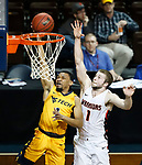 SIOUX FALLS, SD - MARCH 8:  Brandon Shingles #1 of West Virginia University Tech goes for a layup past Indiana Tech defender Joel Froedge #1 at the 2018 NAIA DII Men's Basketball Championship at the Sanford Pentagon in Sioux Falls. (Photo by Dick Carlson/Inertia)
