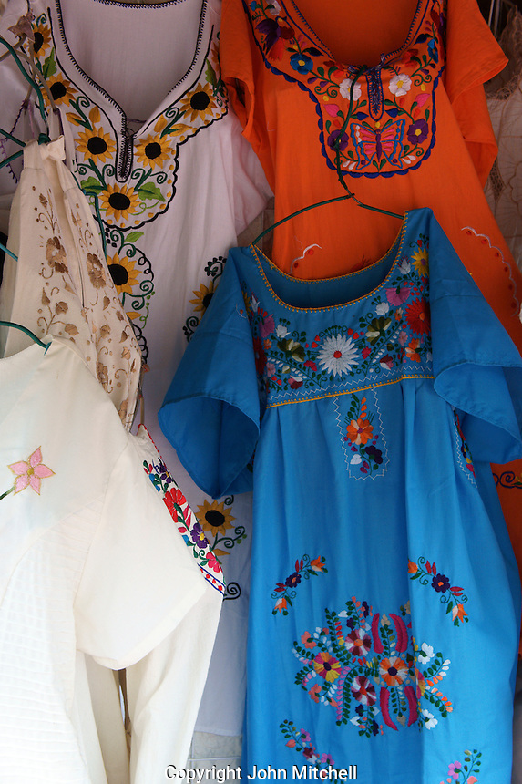 Embroidered dresses for sale at the Mayan ruins of Uxmal, Yucatan, Mexico.