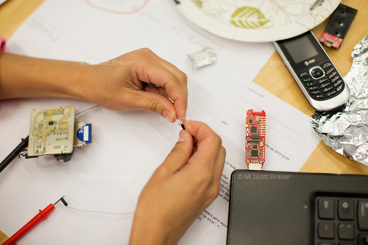 Dr. Suelia Rodrigues Fleury Rosa, Associate Professor of the University of Brasilia Department of Biomedical Engineering, works on a wireless sensor to be inserted in a model of human foot for testing the condition of people with diabetes at MIT's Media Lab in Cambridge, Massachusetts, USA.