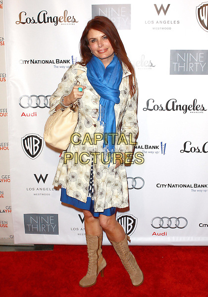 ROMA DOWNEY .Annual Backstage At The Geffen Gala -Arrivals held at The Geffen Playhouse, Westwood, California, USA, .22nd March 2010..full length blue pashmina scarf cream print coat mac trench hand in pocket bag beige suede boots lace-up turquoise ring .CAP/ADM/TC.©T. Conrad/AdMedia/Capital Pictures.