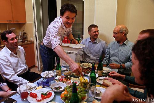 Achimgaz deputy director Ingo Neubert serves Siberian dumplings to colleagues at his home in Novy Urengoi, Siberia, Russia.