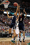 01 APRIL 2012:  Kiah Stokes (41) of the University of Connecticut pulls down a rebound against Notre Dame during the final seconds of regulation at the Division I Women's Final Four Semifinals at the Pepsi Center in Denver, CO.  Notre Dame defeated UCONN 83-75 to advance to the national championship game.  Jamie Schwaberow/NCAA Photos