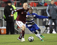Jair Benitez#5 of FC Dallas moves in to tackle Conor Casey#9 of the Colorado Rapids during MLS Cup 2010 at BMO Stadium in Toronto, Ontario on November 21 2010. Colorado won 2-1 in overtime.