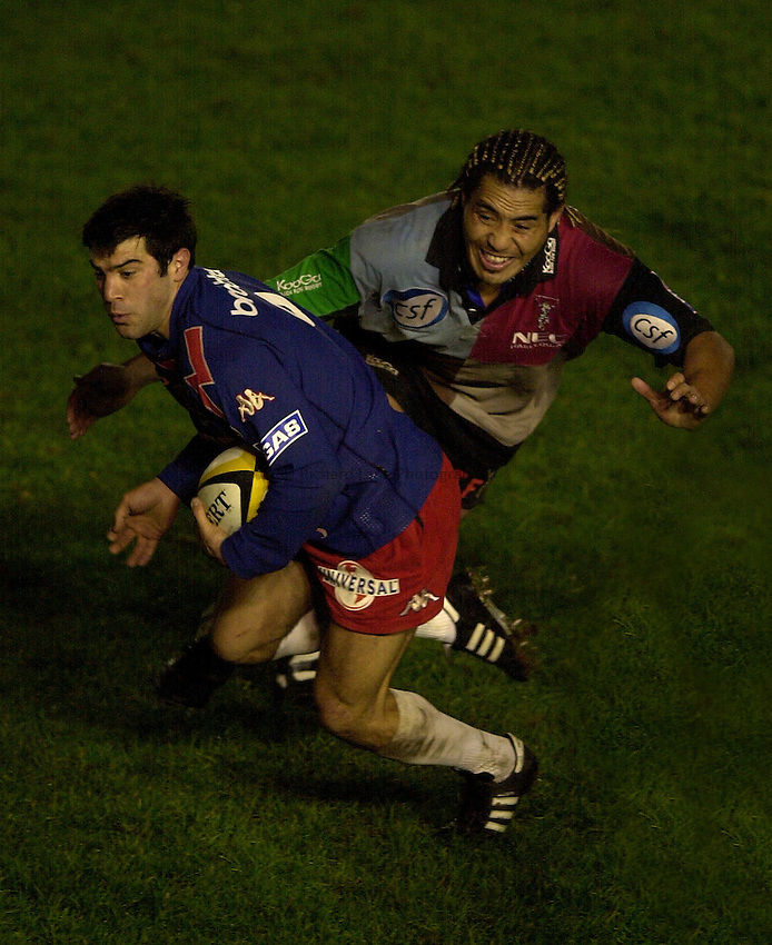 Photo. Richard Lane. .NEC Harlequins v Stade Francais. Parker Pen Challenge Cup 7th December, 2002.Jerome Fillol gets away from Tani Fuga.