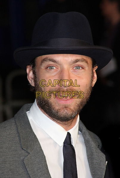 Jude Law.'360' opening gala premiere, 55th BFI London Film Festival, Odeon cinema, Leicester Square, London, England..October 12th 2011.headshot portrait black blue white grey gray hat beard facial hair mouth open smiling.CAP/ROS.©Steve Ross/Capital Pictures