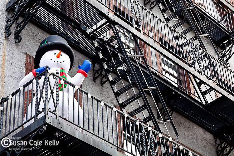 Balcony snowman in the Beacon Hill neighborhood of Boston, MA, USA