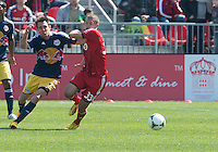 April 27, 2013: New York Red Bulls midfielder Eric Alexander #12 and Toronto FC midfielder Ryan Richter #33 in action during a game between Toronto FC and the New York Red Bulls at BMO Field  in Toronto, Ontario Canada..The New York Red Bulls won 2-1.
