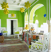 Sharp lemon-yellow polyhedra hang from the ceiling providing an exciting colour contrast with the hot lime-green walls of the study