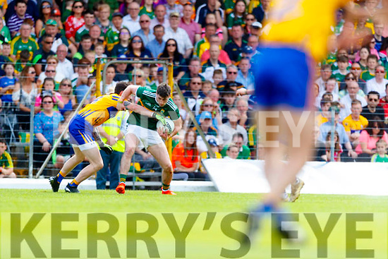 Paul Geaney Kerry in action against Aaron Fitzgerald Clare during the Munster GAA Football Senior Championship semi-final match between Kerry and Clare at Fitzgerald Stadium in Killarney on Sunday.