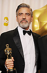 HOLLYWOOD, CA - FEBRUARY 24: George Clooney poses in the press room the 85th Annual Academy Awards at Dolby Theatre on February 24, 2013 in Hollywood, California.