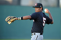 Infielder Cleuluis Rondon (5) of the Kannapolis Intimidators warms up before a game against the Greenville Drive on Friday, April 11, 2014, at Fluor Field at the West End in Greenville, South Carolina. Rondon is the No. 26 prospect of the Chicago White Sox, according to Baseball America.  (Tom Priddy/Four Seam Images)