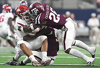 NWA Democrat-Gazette/J.T. WAMPLER Arkansas' Rakeem Boyd gets tackled by Texas A&M's DeShawn Capers-Smith Saturday Sept. 29, 2018 at AT&T Stadium in Arlington. The Aggies beat the Razorbacks 24-17.