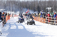 Willow Community trail groomers, led by Bill Luth, groom the start chute just prior to the re-start of the 2011 Iditarod.