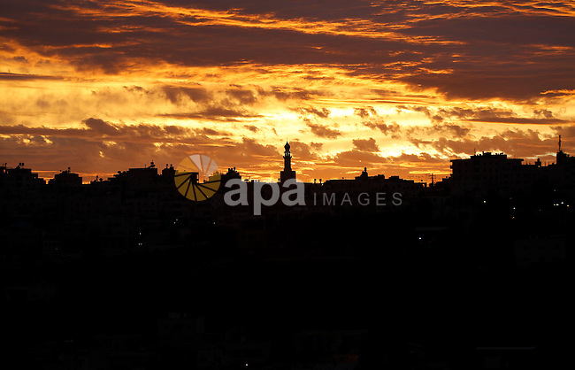 Sunset is seen over the West Bank city of Hebron on Jan. 07, 2016. Photo by Wisam Hashlamoun