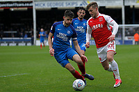 Conor McAleny of Fleetwood Town takes on Jack Baldwin of Peterborough United during the Sky Bet League 1 match between Peterborough and Fleetwood Town at London Road, Peterborough, England on 28 April 2018. Photo by Carlton Myrie.
