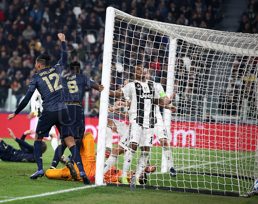 Football Soccer: UEFA Champions League -Group Stage-  Group H - Juventus vs Manchester United, Allianz Stadium. Turin, Italy, November 07, 2018.<br /> Manchester United's Chris Smalling (l) and Paul Pogba (c)celebrates after Juventu's Alex Sandro scored on own goal during the Uefa Champions League football soccer match between Juventus and Manchester United at Allianz Stadium in Turin, November 07, 2018.<br /> UPDATE IMAGES PRESS