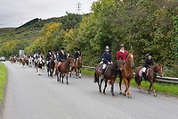 "Pictured: Byron John (C FRONT) with a horse owned by Bradley rides toward Margam Crematorium, Wales, UK. Monday 08 October 218<br /> Re: A grieving father will mourners on horseback at the funeral of his ""wonderful"" son who killed himself after being bullied at school.<br /> Talented young horse rider Bradley John, 14, was found hanged in the school toilets by his younger sister Danielle.<br /> Their father, farmer Byron John, 53, asked the local riding community to wear their smart hunting gear at Bradley's funeral.<br /> Police are investigating Bradley's death at the 500-pupils St John Lloyd Roman Catholic school in Llanelli, South Wales.<br /> Bradley's family claim he had been bullied for two years after being diagnosed with Attention Deficit Hyperactivity Disorder.<br /> He went missing during lessons and was found in the toilet cubicle by his sister Danielle, 12."