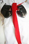 Close up of red belt karate costume tied around stomach black gloves mitts