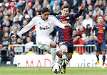 Real Madrid's Raphael Varane (l) and FC Barcelona's Leo Messi during La Liga match.March 02,2013. (ALTERPHOTOS/Acero)