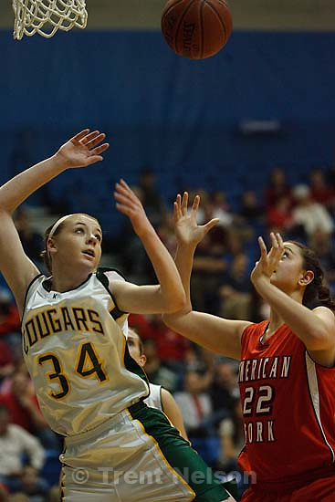 Taylorsville - Kearns' Micalee Orton (34) and American Fork's Makenzie Moeai (22). American Fork vs. Kearns High School girls basketball, 5A State Championship tournament Thursday February 26, 2009 at Salt Lake Community College..