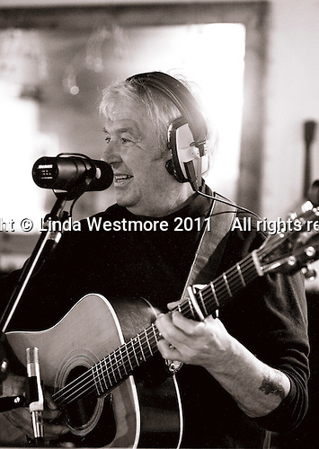"Jim Lee, composer and singer with the ""Edge of Chaos Orchestra"" recording at the Blue Coconut Club, Pulborough, West Sussex."