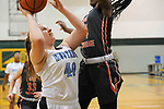 eam goes to the hoop against West's Sunny Pedebone. Photo for the Star by Michael Dinneen