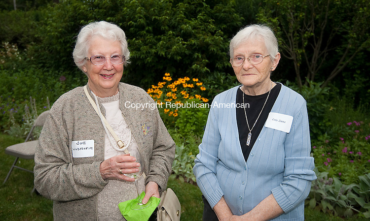 WOODBURY,  CT--- -070916JS11- Sue Windesheim and Lois Zane, both of Woodbury, at the Glebe House Museum's Wine &amp; Roses  garden party held at Glebe House in Woodbury. Proceeds from the event will go to support the renovation and preservation of the Gertrude Jekyll Garden. <br /> Jim Shannon Republican American