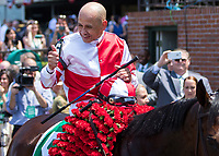 ELMONT, NY - JUNE 10: Mike Smith, aboard Songbird #5, gives a thumbs up as he is led to the winner's circle after winning the Ogden Phipps Stakes on Belmont Stakes Day at Belmont Park on June 10, 2017 in Elmont, New York (Photo by Sue Kawczynski/Eclipse Sportswire/Getty Images)