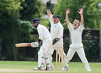 M Rath (R) and M Squibb of Upminster appeal successfully for the wicket of E Khan, caught behind from the bowling of O Peck - Upminster CC vs Gidea Park & Romford CC - Essex Cricket League at Upminster Park - 27/06/09- MANDATORY CREDIT: Gavin Ellis/TGSPHOTO - Self billing applies where appropriate - 0845 094 6026 - contact@tgsphoto.co.uk - NO UNPAID USE.