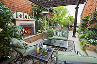 California outdoor garden room with shade pergola and fireplace in small space urban townhome patio garden