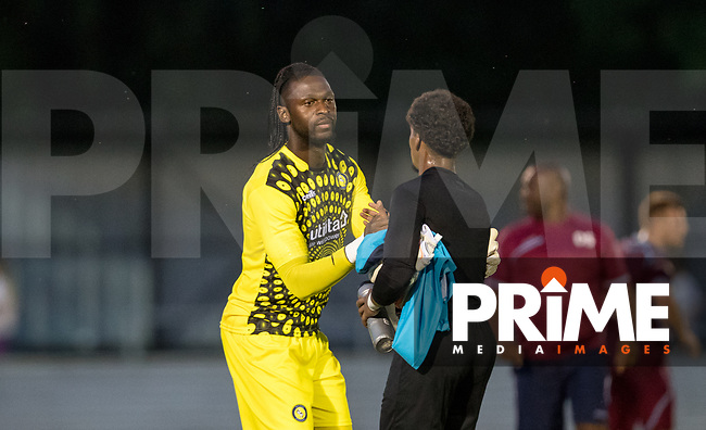 Goalkeeper Yves Ma-Kalambay of Wycombe Wanderers at full time during the 2018/19 Pre Season Friendly match between Chesham United and Wycombe Wanderers at the Meadow , Chesham, England on 24 July 2018. Photo by Andy Rowland.