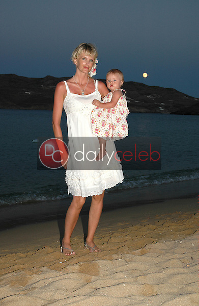 Kylie Bax and daughter Lito Vassiliki Poros on the beach in Panormos, Greece, on the night of Kylie's wedding to Spiros Poros, and the baptism of her daughter.<br />