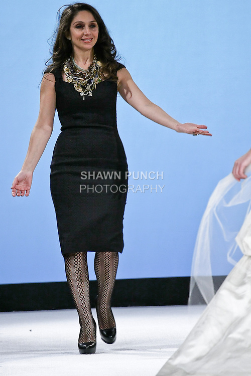 Designer Katerina Bocci walks the runway with a model that is wearing her Speranza ball gown at the close of the Wedding Trendspot fashion show. During the Wedding Trendspot Press Fashion Show at the Waldorf-Astoria; October 18 2009