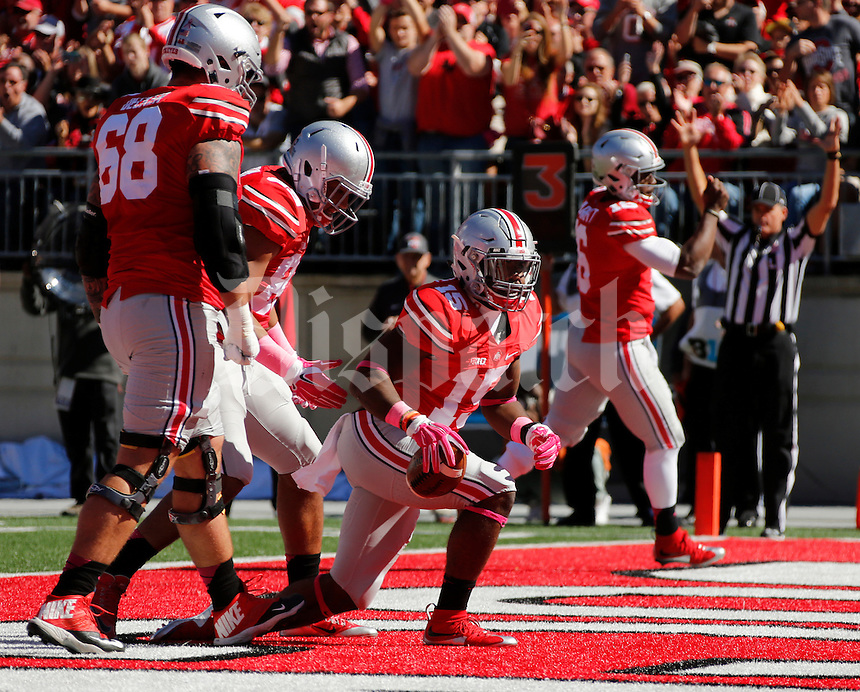 Ohio State Buckeyes running back Ezekiel Elliott (15) scores a touchdown during Saturday's NCAA Division I football game against Maryland at Ohio Stadium in Columbus on October 10, 2015. Ohio State led 21-14 at the half. (Dispatch Photo by Barbara J. Perenic)