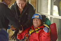 NWA Democrat-Gazette/BEN GOFF @NWABENGOFF<br /> Jacqueline Bettis, a Sunshine School &amp; Development Center adult client, gets fitted for her harness before rappelling Saturday, March 11, 2017, during the Sunshine School &amp; Development Center's rappelling fundraiser with Over The Edge at the 8W Center in Bentonville. The school began a campaign in January, with participants who reached their fundraising goal able to participate in rappelling from the roof of the 6-story building. Over the Edge is a company which specializes in producing events for non profits using equipment and techniques used in commercial rope-access work such as sign installation and window washing. The event had raised more than $57,000 for the school, with more donations still coming in Saturday morning. Located in Rogers, the Sunshine School &amp; Development Center serves children and adults with developmental dissabilities, including a preschool.