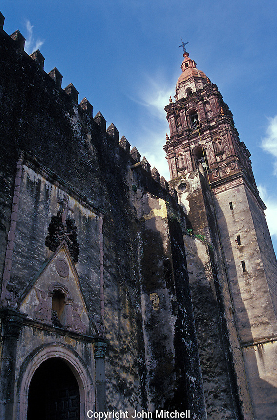 Facade of the 16th-century cathedral or Templo de la Asuncion de Maria in Cuernavaca, Morelos, Mexico.