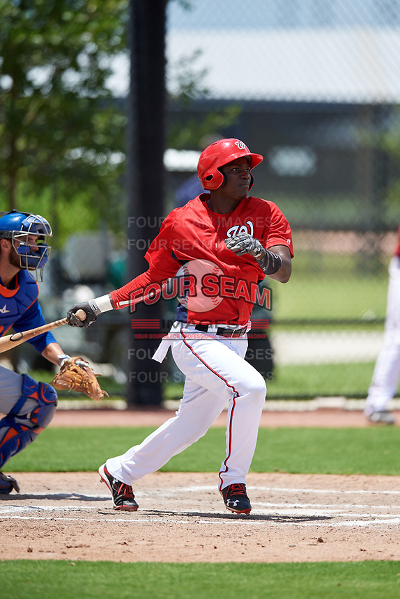 GCL Nationals center fielder Caldioli Sanfler (9) follows through on a swing during a game against the GCL Mets on August 4, 2018 at FITTEAM Ballpark of the Palm Beaches in West Palm Beach, Florida.  GCL Nationals defeated GCL Mets 7-4.  (Mike Janes/Four Seam Images)