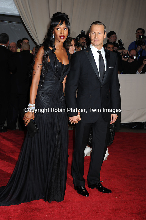 Naomi Campbell and boyfriend  Vladimir Doronin arriving at The Costume Institute Gala Benefit celebrating American Woman: Fashioning a National Identity at The Metropolitan Museum of Art on May 3, 2010 in New York City.