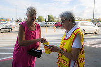 NWA Democrat-Gazette/CHARLIE KAIJO Kathleen Lang of Seligman (from left) makes a donation to Jean Schmitz of Bella Vista during a Tootsie Roll drive, Friday, October 5, 2018 at Walmart in Rogers.<br /><br />The Knights of Columbus is kicking off their annual tootsie rool drive Friday. The fundraiser runs through Oct. 13. They hand out Tootsie Rolls and accept donations, similar to the VFW poppy campaign.