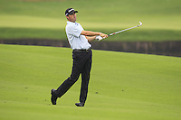 Ryan Palmer (USA) plays his 2nd shot on the 11th hole during Friday's Round 2 of the 2014 BMW Masters held at Lake Malaren, Shanghai, China 31st October 2014.<br /> Picture: Eoin Clarke www.golffile.ie