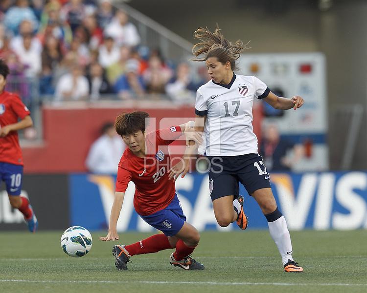 Korea Republic defender Kim Hyeri (20) disrupts USWNT midfielder Tobin Heath (17) advance. In an international friendly, the U.S. Women's National Team (USWNT) (white/blue) defeated Korea Republic (South Korea) (red/blue), 4-1, at Gillette Stadium on June 15, 2013.