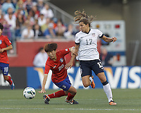 Korea Republic defender Kim Hyeri (20) disrupts USWNT midfielder Tobin Heath (17) advance. In an international friendly, the U.S. Women's National Team (USWNT) (white/blue) defeated Korea Republic (South Korea) (red/blue), 4-1, at Gillette Stadium on June 15, 2013.